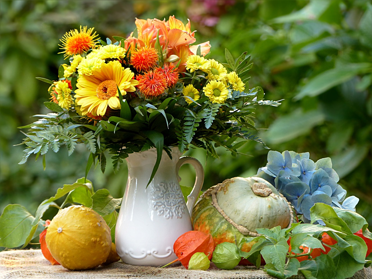 Beautiful Autumn Bouquet of Flowers with Pumpkins